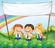 An empty banner above the three young students Stock Images