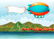 The empty banner carried by the colorful airship. Illustration of the empty banner carried by the colorful airship Stock Photo