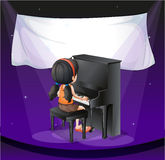 An empty banner near the girl playing with the piano Royalty Free Stock Images