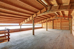 Empty barn inside with wooden trim Royalty Free Stock Photos