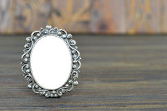 Empty baroque picture frame. On wooden background Royalty Free Stock Photos