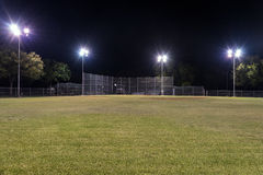 Free Empty Baseball Field At Night With The Lights On Royalty Free Stock Photo - 60472395