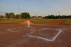 Empty Baseball Field at Dusk Stock Photos