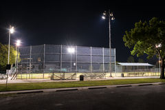 Empty baseball field with the lights on at night Royalty Free Stock Image