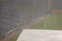 Empty baseball stands in rain delay Stock Image