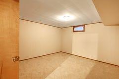 Empty basement bedroom Royalty Free Stock Photography