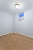 Empty basement bedroom Stock Photography