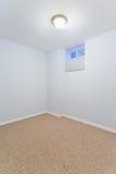 Empty basement bedroom Royalty Free Stock Image