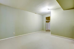 Empty basement room in ivory color with pantry. Empty basement room in ivory color with pantry in American rambler house. Northwest,USA royalty free stock photo