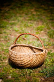 Empty basket. Closeup of an empty thatched basket on grass Stock Photo