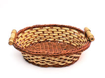 Empty basket. Close up of the empty wicker basket isolated on the white background Royalty Free Stock Photography