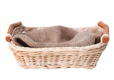 Empty basket with cloth isolated. Royalty Free Stock Images