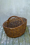 Empty basket. Old empty basket on the wooden table Royalty Free Stock Image