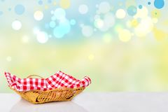 Empty basket with red checkered napkin on white table in front stock images