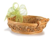 Empty basket with ribbon. Christmas basket isolated over white background Stock Photos