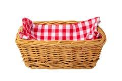Empty basket therein a red checkered napkin isolated on white ba stock photos