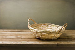 Empty basket on wooden table Stock Image
