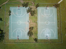 Empty basketball field. Aerial drone view in school park Royalty Free Stock Photo