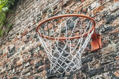 Basketball hoop hanging on a aged wall royalty free stock photography