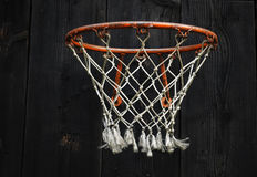 Empty Basketball Net. Empty Red and Wihe Basketball Net on Black Wooden Background Stock Images
