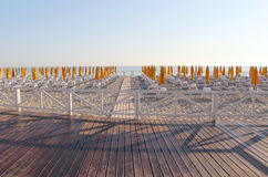 Empty bathing establishment, early in the morning. A view of an empty bathing establishment, with a  white wooden fence in the foreground, at the beach of Stock Photos