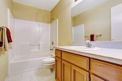 Empty bathroom interior in soft ivory Stock Image