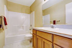 Empty bathroom interior in soft ivory Royalty Free Stock Image