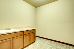 Empty bathroom interior with vanity cabinet and tile floor. Northwest, USA Stock Photo