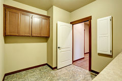 Empty bathroom interior with vanity cabinet and tile floor. Northwest, USA Royalty Free Stock Photo