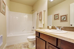 Empty bathroom in soft ivory color with tile wall trim Stock Image