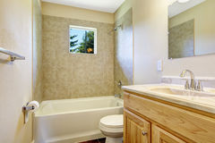 Empty bathroom with tile wall trim and window Stock Image
