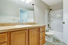 Empty bathroom with wooden vanity cabinet Stock Photography