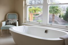 Empty bathtub in bathroom. At home Stock Images