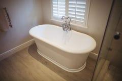 Empty bathtub in bathroom. At home Royalty Free Stock Photos