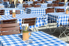 Empty Bavarian Beer garden with blue white tablecloth Stock Photography