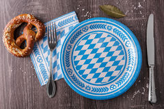 Empty bavarian plate with pretzel Royalty Free Stock Image