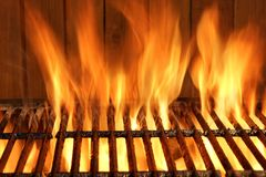 Empty BBQ Flaming Grill And Wood Wall In The Background Stock Photography