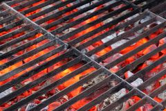 Empty BBQ Grill and Glowing Hot Coals. Background with space for text or image Stock Photos