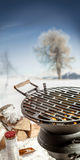 Empty BBQ grill with hot coals in winter Stock Image