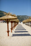Empty beach. Deserted beach and beach umbrellas royalty free stock images