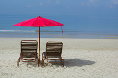 Empty beach. Chaise longue on empty beach Royalty Free Stock Photos