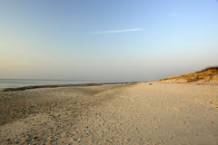 Empty Beach. View of an empty beach, and water and sky beyond royalty free stock photos