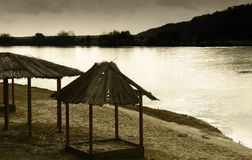 Empty beach. Gazebo are covered with reeds on an empty beach Royalty Free Stock Photo