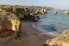 Empty beach in Algarve at south of Portugal Royalty Free Stock Photo