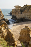 Empty beach in Algarve at south of Portugal Royalty Free Stock Photos