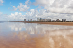 Empty beach Atalaia, Aracaju, Sergipe state, Brazil. Empty beach Atalaia with view of city on background, Aracaju, Sergipe state, Brazil. Selective focus Royalty Free Stock Image