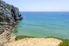 Empty beach at the Atlantic Ocean in Sagres, Portugal Royalty Free Stock Photos