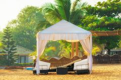 Empty beach awning with sun loungers. Tinted stock images