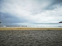 Empty beach with a blue sky royalty free stock photography