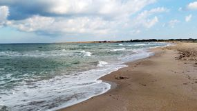 Empty beach of the black sea, heavy clouds and soon the storm royalty free stock photo